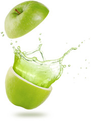 Wall Mural - juice splashing out of a green apple isolated on white background