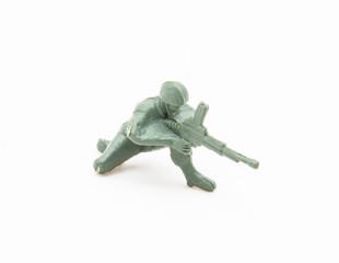 Plastic toy soldier with machine gun