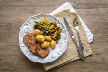 Meatloaf, potatoes and vegetable dinner