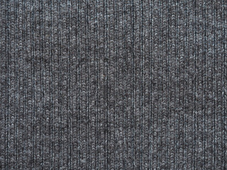 Texture fabric wool, knitted gray pattern close-up. Knitwear, background of oxford gray woolen