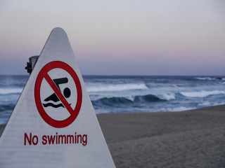 No swimming. Signpost on Sokcho beach. South Korea.