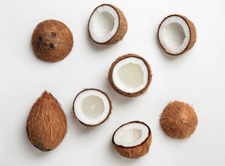 Coconut water and fresh nuts on white background