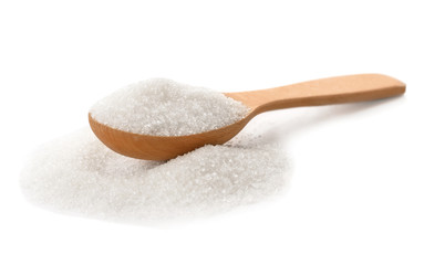 Wooden spoon with pure sugar on white background Wall mural
