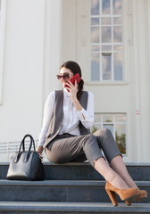 Woman business suit, handbag,  smart phone