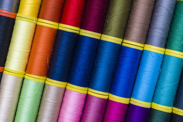 Background of colourful thread spools