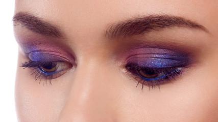 Elegance close-up of beautiful female eye with fashion eye shadow and eyeliner. Macro shot of woman's beautiful eye with extremely long eyelashes. Sexy makeup. Retro make-up