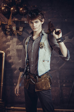 Male portrait in steampunk style on a dark background.