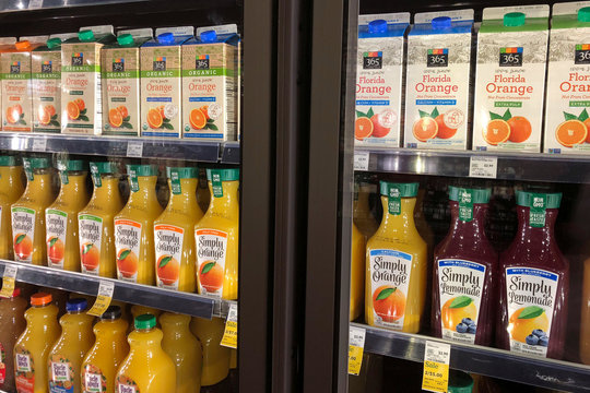 Coca-Cola Co's Simply Orange is displayed next to Whole Foods' private label 365 Everyday Value orange juice in Venice