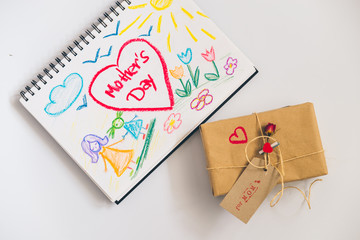 child picture for mothers day with craft gift box on white background