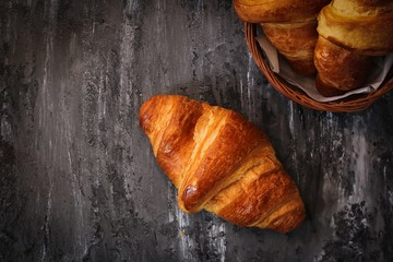 Homemade Butter Croissants on dark moody background, selective focus