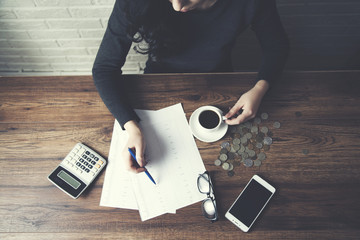 woman hand document and coffee on table