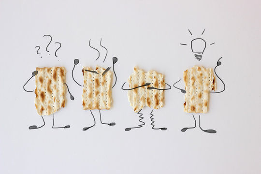 Illustration of the four sons mentioned in the Haggadah book on pieces of Matzah bread