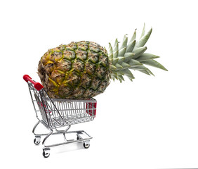 Shopping cart with pineapple isolated on white background