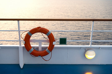 Buoy or lifebuoy ring on shipboard in evening sea in miami, usa. Flotation device on ship side on seascape. Safety, rescue, life preserver. Water travel, voyage, journey. Wanderlust, vacation, trip