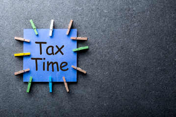 Tax time - Notification of the need to file tax returns, tax form at accauntant workplace with empty space for text, mockup or template