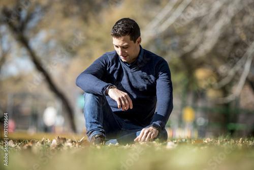 Male model posing in the park