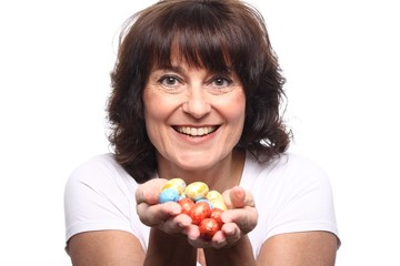 Mature woman with easter eggs