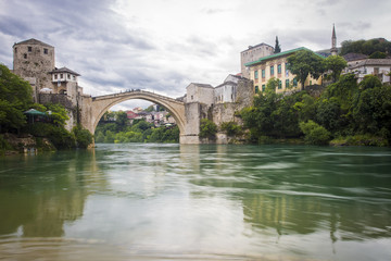 View of the single-arch Old Bridge or Stari Most Neretva over River in Mostar, Bosnia and Herzegovina. The Old Bridge was destroyed in 1993 by Croat military forces during the Croat–Bosniak War.