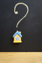 miniature model house and question mark
