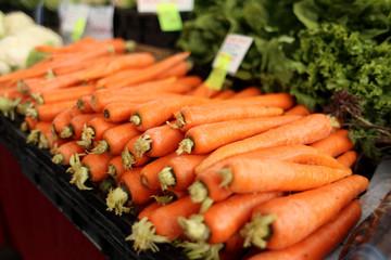 Fresh organic carrots at a farmer's market.
