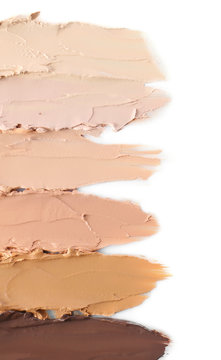 Different shades of foundation on white background. Professional makeup products