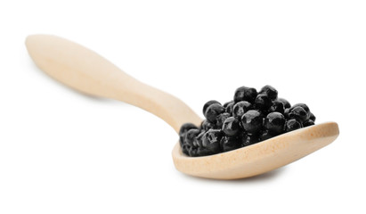 Ceramic spoon with black caviar on white background