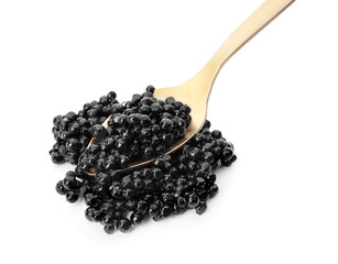 Metal spoon with black caviar on white background