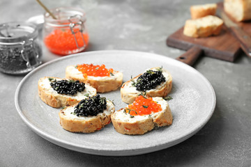 Sandwiches with black and red caviar on plate