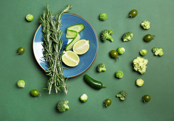 Flat lay composition with green vegetables and fruits on color background. Food photography