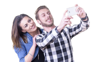 Young couple in love, married or otherwise, taking a selfie with a smart phone