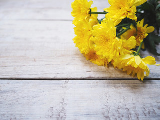 Yellow Chrysanthemums flowers on vintage white wood.