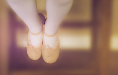 close up small ballet shoes with blurred background, filtered tones
