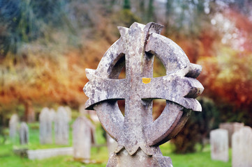 Old concrete cross in british cemetery