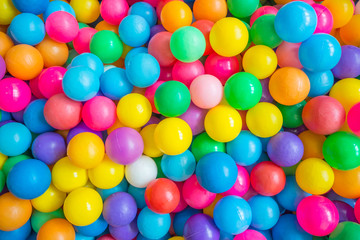 Top view of many colorful balls in ball pool at indoors playground
