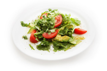 Salad with tomatoes, parsley, avocado on white background