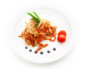 Noodles with tomato sauce and vegetables on white background