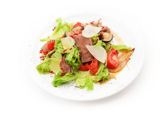 Salad from meat, cheese, tomato, mushrooms and salad leafs on white background