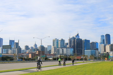 Cyclists and Melbourne cityscape Australia