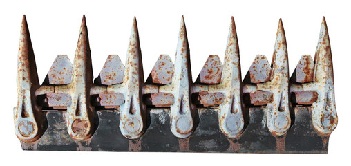 Dangerous sharp teeth of an old rusty agrotechnical mower