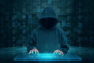 Hacker with hoodie using virtual keyboard to hacking system