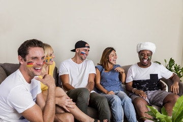 Multinational sports fans laughing and having fun with Russian hat