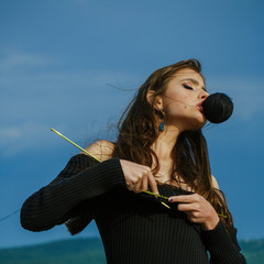 Fashion and beauty, girl on blue sky. fashion knitting style of young girl on blue sky