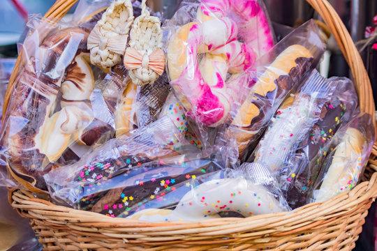 basket full of colorful glazed pretzels in package