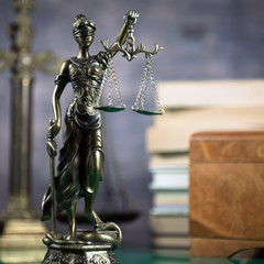 Law concept with Themis, symbol of justice.