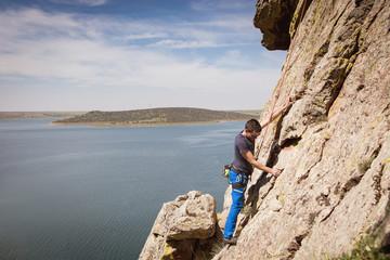 man climbing a rock wall