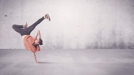 Pretty urban dancer with empty background