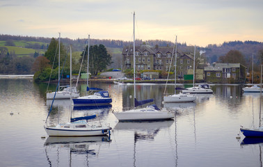 Yachts on still waters at a marina at lake windermere, England UK.