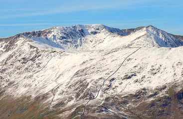 Snow covered mountains of Helvellyn, Striding Edge and Swirral Edge in the Lake District, England, UK.