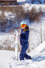 Image of female athlete wearing helmet with snowboard standing in park