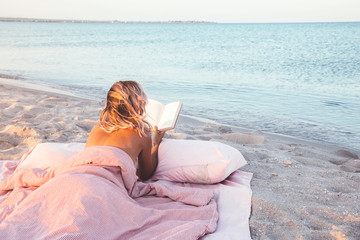 Relaxing and reading book near the sea